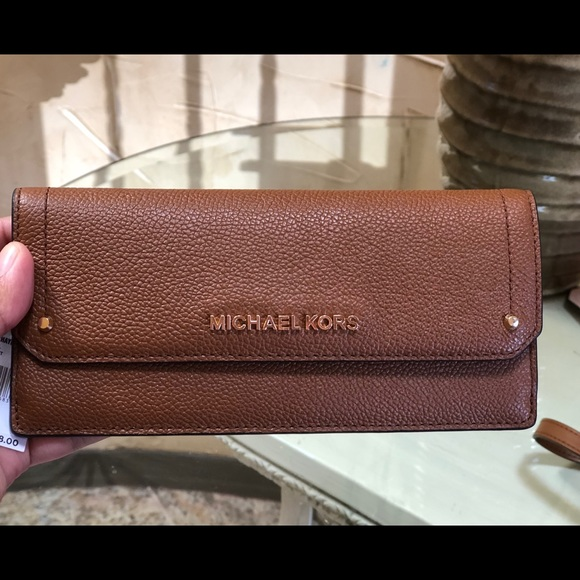 be1cb688e807 Michael Kors Bags | Hayes Flat Wallet Leather Luggage | Poshmark